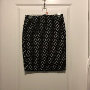 Cream colored pencil skirt with black overlay